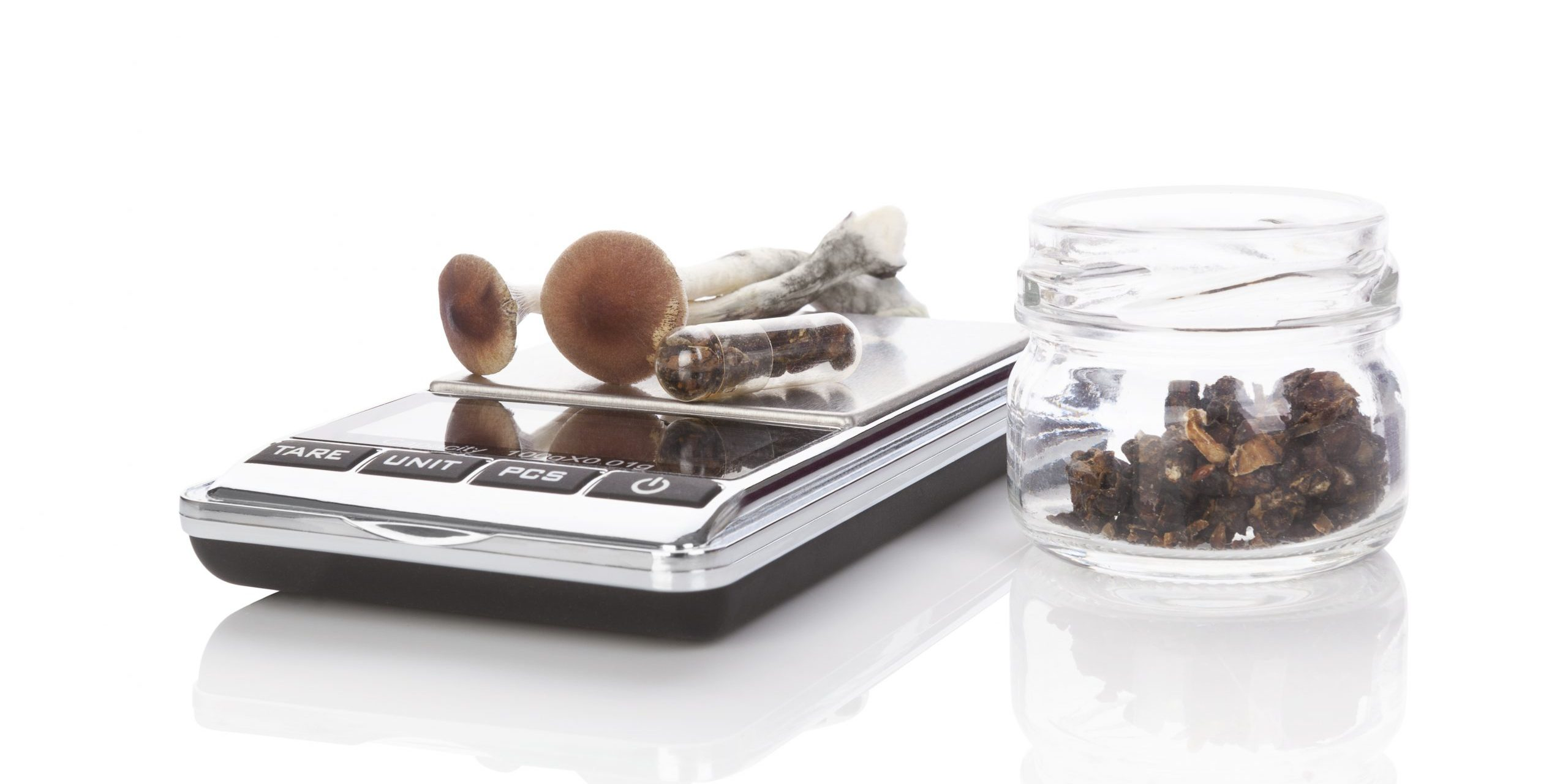 microdosing psilocybin the active ingredient in magic mushrooms - shrooms, using a microscale to create microdoses inside capsules
